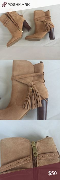 "NWOB Tommy Hilfiger💐Heeled Tassel Suede Boot Cute brown suede heeled short boot. It has strap details with two tassels and a TH medallion. Inner zip. 3.5"" heel.   🌟same day shipping on orders before 12 pm🌟next day shipping on all others🌟10% bundle discount(and others, see bundle listing at top of closet)🌟make me an offer!🌟 Tommy Hilfiger Shoes Heeled Boots"