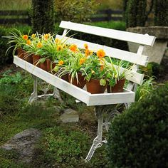 An old garden bench becomes the perfect place for a collection of containers. via BHG. This BHG site has 32 amazing ideas; please check this out!!