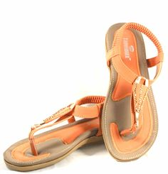 Pop Fashionista:  Orange combined with beige gives a cool look, crystals embedded on the upper strap gives it that extra chick look. The whole ensemble adds style to your gait. The sole with a flowery design to give it a complete look. The gorgeous feet of a fashionista like you deserves nothing but the best. Please like us on www.facebook.com/LadyFingerShoes ‪#‎LadyFinger‬ ‪#‎womenshoes‬ ‪#‎girlsfootwear‬ ‪#‎shoes‬