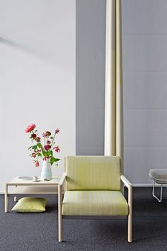 Scholten & Baijings upholsters Herman Miller seating in gridded fabric.
