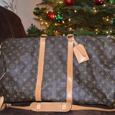 Louis Vuitton Keepall Beautiful bag. Watermarks on straps. Good condition. Authentic. Comes with extra strap. Free Poshmark Concierge Authentication Louis Vuitton Bags Travel Bags