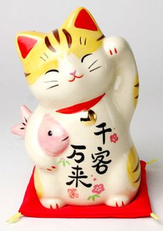 The maneki-neko is sometimes also called the welcoming cat, lucky cat, money cat, happy cat, or fortune cat in English.