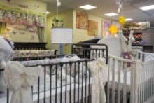 Decorative Bows On The Outside Of The Iron Crib In White Silk Fabric For An  Elegant