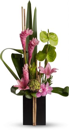 Now and Zen tropical bouquet. Love the two bamboo sticks in front of the container. lr