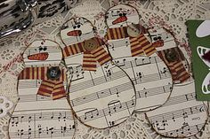 sheet music snowmen! I could use this and make a wreath for music…