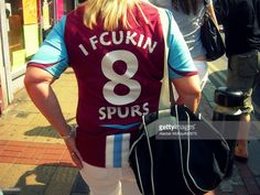 CONTENT] A fan of West Ham United football club displays the traditional rivalry…