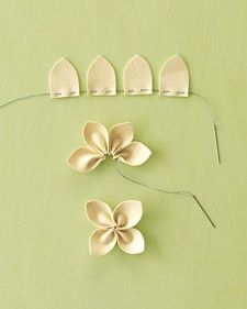 I love these simple flower embellishments... to sew on cardigans, pillows... the options are endless! craftiness