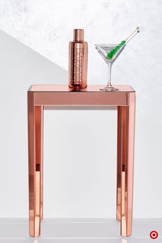 If there's one thing that makes the holidays more festive, it's shine. And interior accents in cool, copper tones are the perfect, on-trend way to upgrade your holiday style game. Try a hammered cocktail shaker or even a mirrored copper side table to help set the scene at your Holiday party.