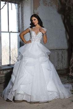 BALL GOWN WITH DRAPED SKIRT AND DRAMATIC INTRICATE BEADING, JEWELED ILLUSION NECKLINE