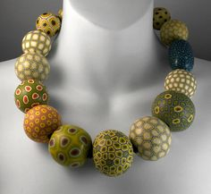Fiddleheads and Moss Necklace: Melanie West// polymer and rubberlove I love the colours in these beads.
