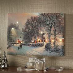The candles are lit in the windows after a fresh snowfall, and the boys are sledding with the family dog in tow.  10 LED lights illuminating the scene behind a colorful screen print on canvas. Uses 2 AA batteries.