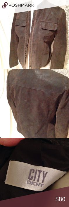 DKNY brown leather motorcycle jacket This is a DKNY buttery soft suede leather motorcycle jacket. Beautiful rich dark brown color. 100% leather with silky smooth lining. Size 6, runs a little large. This jacket has been gently used with only showing slight wear on interior collar seam and back seam. The leather suede is slightly distressed by manufacturer to give it that edgy style of a favorite jacket that has seen many adventures. You will love this classic piece. Will accept offers DKNY…