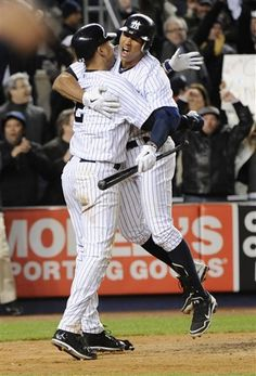 GAME 19: Friday, April 27, 2012 - New York Yankees' Derek Jeter, left, celebrates with teammate Alex Rodriguez after scoring on a passed ball during the ninth inning of a baseball game against the Detroit Tigers at Yankee Stadium in New York. The Yankees defeated the Tigers 7-6. (AP Photo/Bill Kostroun)
