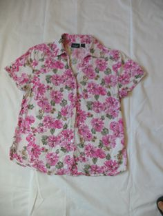 Pretty floral blouse, Vintage from the 80s, short sleeves Soft button down blouse, darts at the bust, collar, floral print, Womens Size Medium. Good vintage condition Tag: Gloria Vanderbilt Causals, M, Made in Indonesia Inner seam tag: 55% cotton 45% rayon So sweet and pretty, with pink flowers and sage green leaves on white background. Great staple for spring and summer. Comfy in cotton rayon blend, gives it a soft silky feel. Nice with denim or skirts, soft, romantic, granny chic, co...