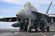 Sailors launches a jet. by Official U.S. Navy Imagery, via Flickr