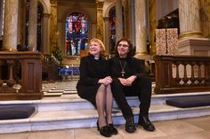 Tony and Rev. Catherine Ogle sitting on the steps of Birmingham Cathedral...