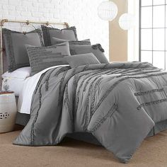 Bring a touch of the sea to your master suite with this lovely comforter set, featuring ruffled stripes for a touch of texture.