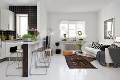 bar stools; open plan kitchen/ living