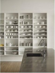 Wall Mounted Kitchen Shelves | Above: Shelving in a loft by Philadelphia-based Qb3 Design .
