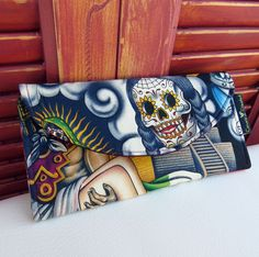 Sugar Skull or Pyramid Tri-fold Wallet  Perfect wallet or large enough to use as a clutch. Beautiful Contigoprint from Alexander Henry on the exterior and black durable fabric on the interior. Pocket behind the zipper pouch is large enough to hold a cell phone securely.