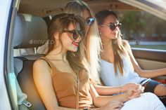 The pretty european girls 25-30 years old in the car make photo on mobile phone by master1305. The pretty european girls 25-30 years old in the car making photo on mobile phone