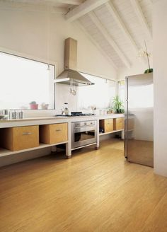 Plywood boxes create useful kitchen storage. [Love the open shelving in this kitchen!]