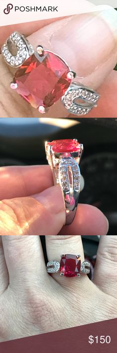 14 KT white gold Cocktail Ring/Ruby This is from Australia, and was a past purchase. It is absolutely stunning. Beautiful cocktail ring. Stamped 14 kt. Ruby and white topaz a must see. Size 9. Jewelry Rings