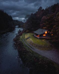 A riverside cabin in The Lake District in northwest England. Photo by Cabin In The Woods, Cabin On The Lake, House Near Lake, Summer Cabins, Seen, Cabins And Cottages, Tiny House Plans, Cozy Place, Cabin Plans