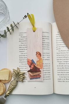 Keep track of your place in a favourite book, journal or magazine with this unique handmade wood vintage pin up girl bookmark. You will no longer need to reach for an old receipt or scrap of paper to mark your place…and no more folding the corners of pages! Each bookmark is handmade in Australia using lightweight, flexible wood, gorgeous photo image transfer and finished with coloured ribbon. #stitchandwood #bookmark #vintage #pinup #giftidea Flexible Wood, Wood Transfer, Ribbon Colors, Book Journal, Pin Up Girls, Book Lovers, Are You The One, Bookmarks, Pinup