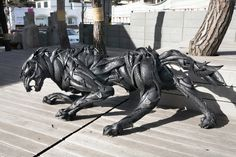 Wolf Sculpture created with layers of used rubber tires, by Yong Ho Ji.