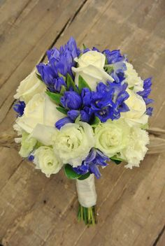 White and blue bridal bouquet with gentiana, blue delphinium,roses and lisianthus. Designed by Forget-Me-Not Flowers in Banff.