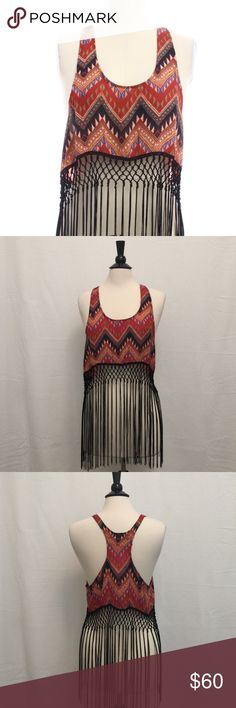 LF Chandelier Top Trendy tribal print top, soft with flowing fringes hanging from the braided mid section. Bought here for a vacation trip,but never used it. ♦️No trades. LF Tops Tank Tops