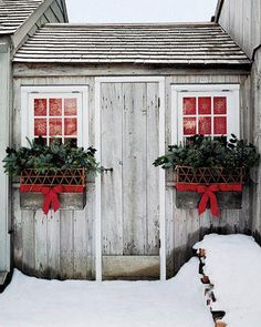 TIE RED RIBBON AROUND WINDOW BOXES -----GREENERY, LIGHTS. MERRY CHRISTMAS!!!!!