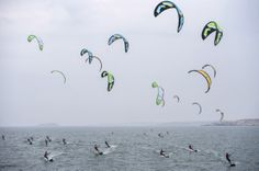 Kiteboarders start a day of competition