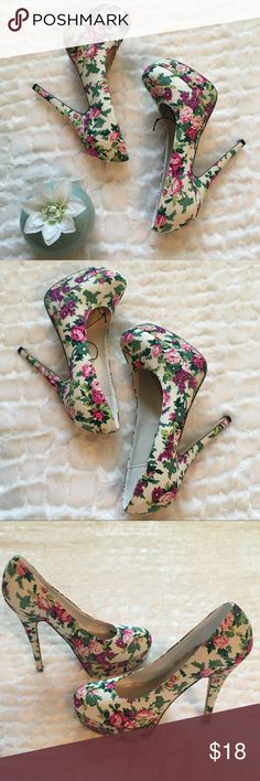 💎Forever 21 floral 5 1/2 inch platform heels SZ 9 Forever 21 floral 5 1/2 inch platform heels size 9. Platform measures 1 1/2 inch. Never worn. Small creases on right shoe pictured. White with pink and purple floral design. Great condition Forever 21 Shoes Heels