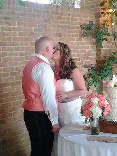 A kiss before cutting the cake