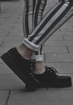 black 90s grunge shoes with striped skinnies
