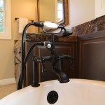 Antique faucet adds to the look and feel of the claw tub for this bathroom remodel.