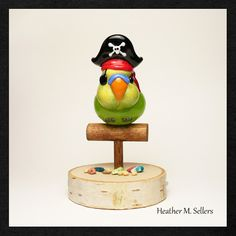 Heather Sellers designed and created this flamework glass pirate parrot.