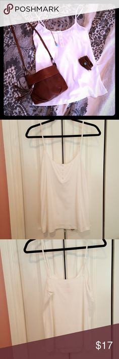 Torrid White Tank White tank by torrid featuring adjustable straps and has a button detail in front. In excellent used condition. Torrid Tops Tank Tops