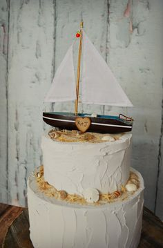 This listing is for one sailboat wedding cake topper for a nautical themed wedding. The sailboat will come with the bride and grooms initials.