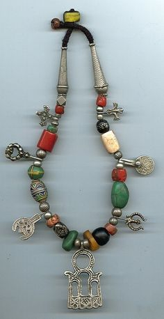 Antique Moroccan (Berber) Hamsa/door charm necklace with bird foot or pidgeon foot, symbollic of new life within a Khrab hoop, representing new life emerging through the portal of life (womb). Ethnic Jewelry, Moroccan Jewelry, Gypsy Jewelry, African Jewelry, Jewelry Art, Beaded Jewelry, Jewelry Design, Custom Jewelry, Handmade Jewelry