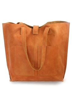 "Ebise Leather Tote is handcrafted in Ethiopia with 100% genuine distressed leather. - Leather Tote measures 12'' H x 16 1/4'' W x 4 1/2'' D - Comfortable, durable straps (straps have a 11"" drop) - It"