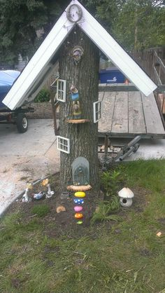 Gnome house made out of tree stump, used pic frames for windows, painted rocks for stairs
