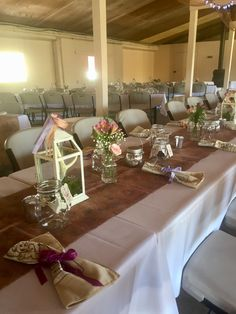 Barbecue wedding at Smokey Glen Farm: Floral burlap table runner with small bud vases filled with alstromeria, fern, baby's breath, and ranunculus. Mercury glass tea lanterns, tea votives, and real branch votives are scattered along the tables. Tan bandanna napkins tied with lavender, plum, ivory, or peach ribbons are at each place setting, along with guest favor mason jar mugs. Barbecue Wedding, Mason Jar Mugs, Burlap Table Runners, Baby's Breath, Ranunculus, Mercury Glass, Place Settings, Bud Vases, Color Themes
