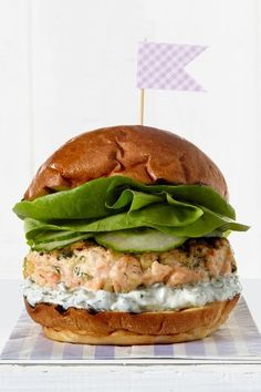 Get creative and swap your usual burger for salmon, topped with tangy tzatziki and sliced cucumbers.  Recipe: Tzatziki Salmon Burger   - CountryLiving.com