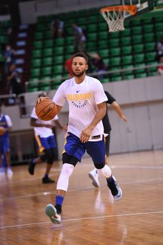 Stephen Curry of the Golden State Warriors dribbles the ball during practice and media availability at Shenzhen Gymnasium as part of 2017 NBA Global...