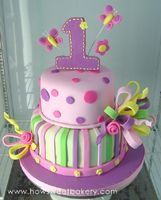 first birthday cake with large number one, huge bow, roses and butterflies on top