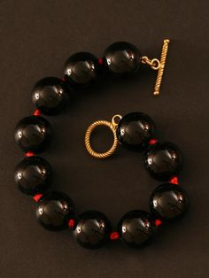 Randi Elyse Black Onyx Ball Bracelet with Red String and Vermeil Toggle Clasp. $295.00