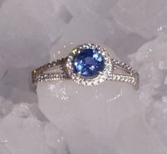 Ice Castles proposal in Colorado :  wedding blue engagement halo ring sapphire